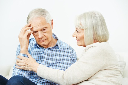 Old Woman Comforting Senior Man With Depression At Home